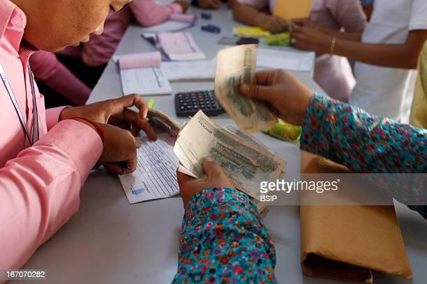 Asian scene Microcredit reimbursement in the Pochentong branch office of Chamroeun microfinance