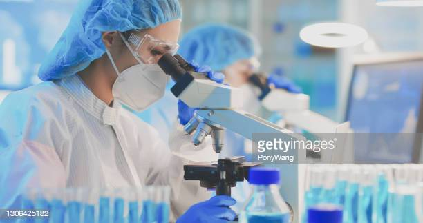 asian scientist use microscope - taiwan stock pictures, royalty-free photos & images