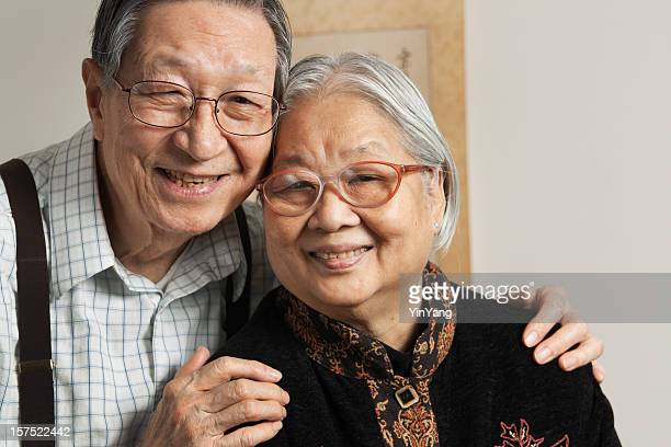 Asian Senior Couple, Two Chinese Grandparents Smiling Cheerfully in Retirement