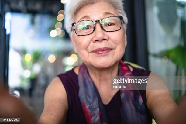 Asian senior lady taking her selfie.
