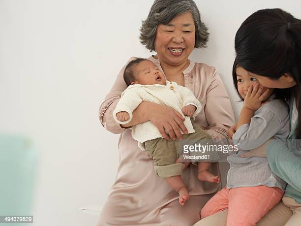 Asian senior woman with daughter and two granddaughters
