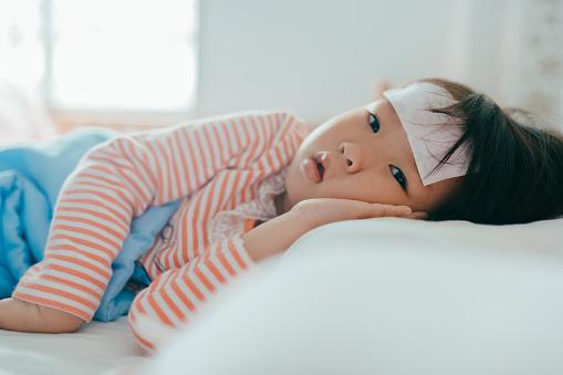 Asian sick little girl sleeping in bed - gettyimageskorea