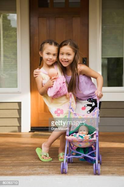 Asian sisters hugging