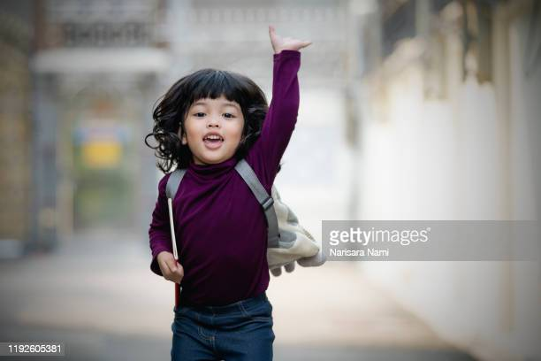 asian smile cute child girl with book is ready for going to kindergarten school for the first time. - 初めての出来事 ストックフォトと画像