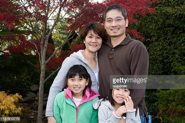 Asian Smiling Happy Family Portrait Outdoors, Copy Space