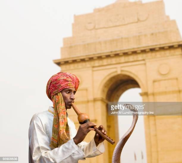 Asian snake charmer playing flute