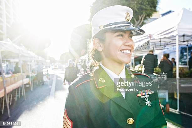 asian soldier smiling in farmers market - hero and not superhero stock pictures, royalty-free photos & images