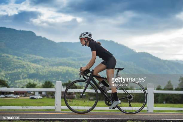 asian sporty girl cycling and exercise on bike in track and open road  work out and sport concept - evento ciclistico foto e immagini stock