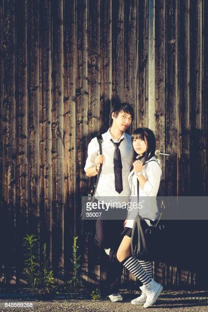 asian student couple with school uniform - korean teen stock pictures, royalty-free photos & images