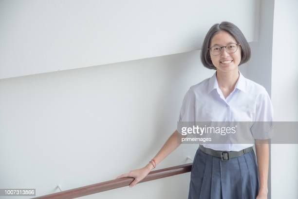 asian student girl reading book in public library - thai ethnicity stock pictures, royalty-free photos & images