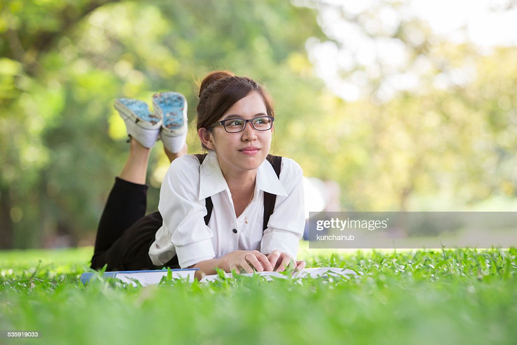 Asian student in park : Stock Photo