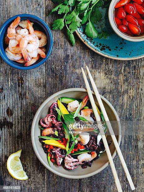 asian style salad - black rice stock pictures, royalty-free photos & images
