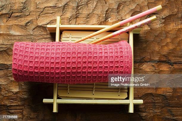 Asian table accessories: hand towel, chopsticks, bamboo mat