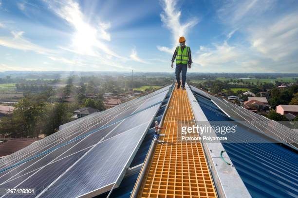 asian technician checks the maintenance of the solar panels, engineering team working on checking and maintenance in solar power plant to innovation of green energy for life on factory roof. - business stock pictures, royalty-free photos & images