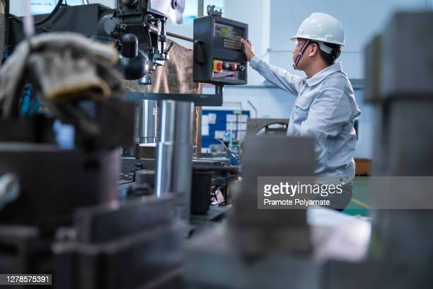 asian technician working are tapping  steel hole punching machine - strike industrial action stock pictures, royalty-free photos & images
