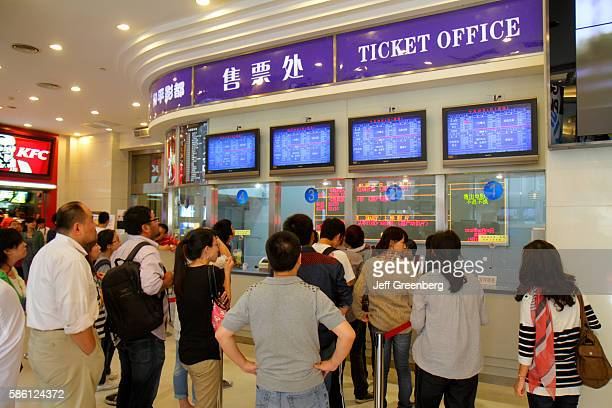 Asian teen at the movie theatre ticket window