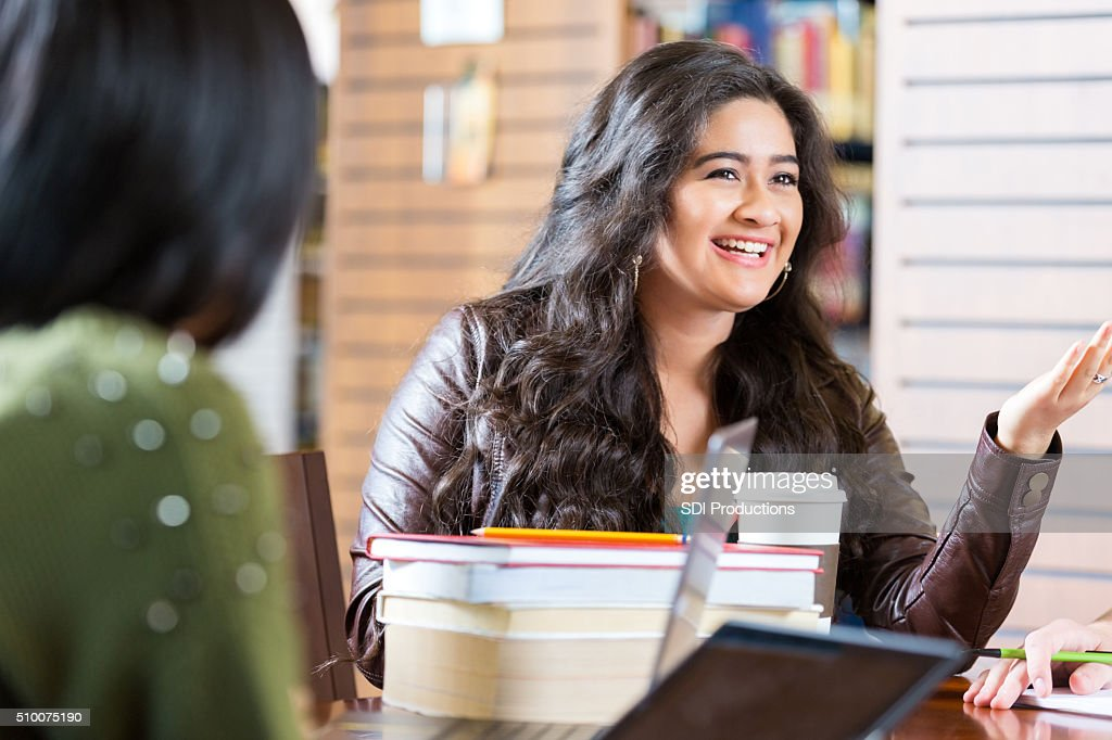 Asian Teen Girl Talking With Study Group In Library Stock -9133