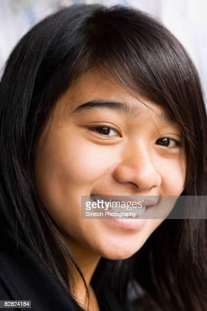 Asian teenage girl smiling