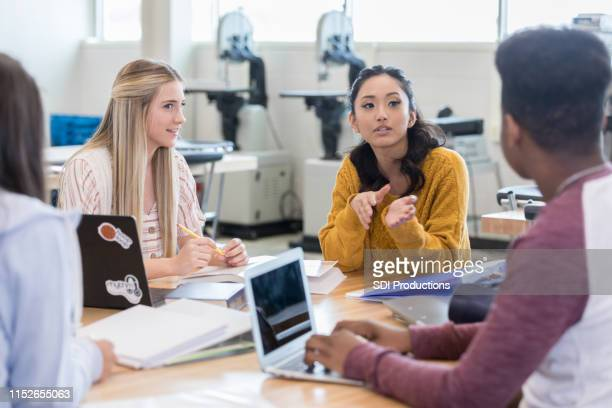 asian teenage girl talks withe classmate - teenagers only stock pictures, royalty-free photos & images