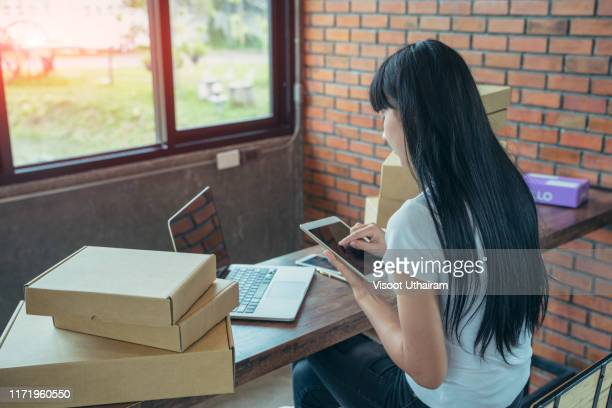 asian teenager owner business woman work at home for online shopping - returning merchandise stock pictures, royalty-free photos & images