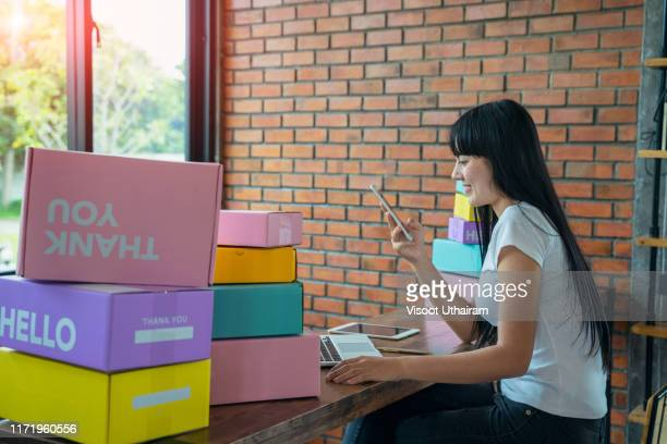 asian teenager owner business woman work at home for online shopping - e commerce stock pictures, royalty-free photos & images