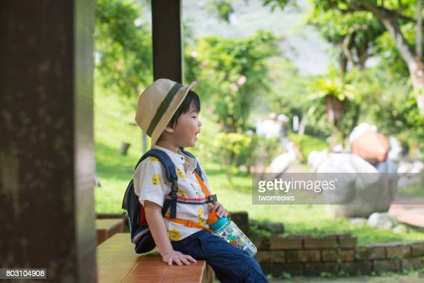 Asian toddler boy in field trip.