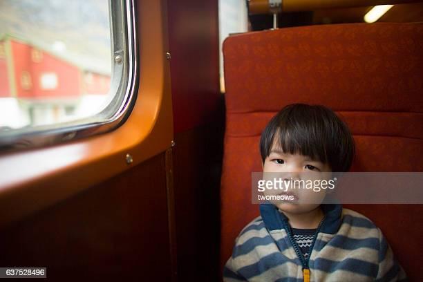 Asian toddler boy in train.