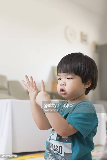 Asian toddler boy learn to count.