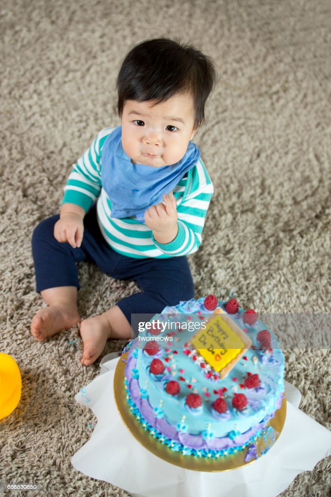 Asian Toddler Boy Tasting Cream On Birthday Cake Stock Photo Getty