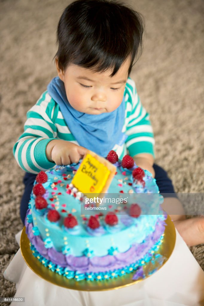 Asian Toddler Boy With Birthday Cake Stock Photo Getty Images
