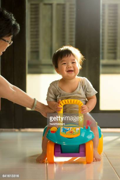 Asian toddler learn to ride.