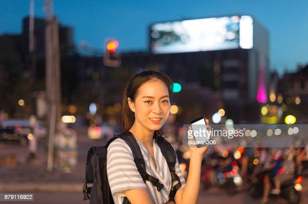 Asian tourist female use smart phone for nevigate route and map for travel