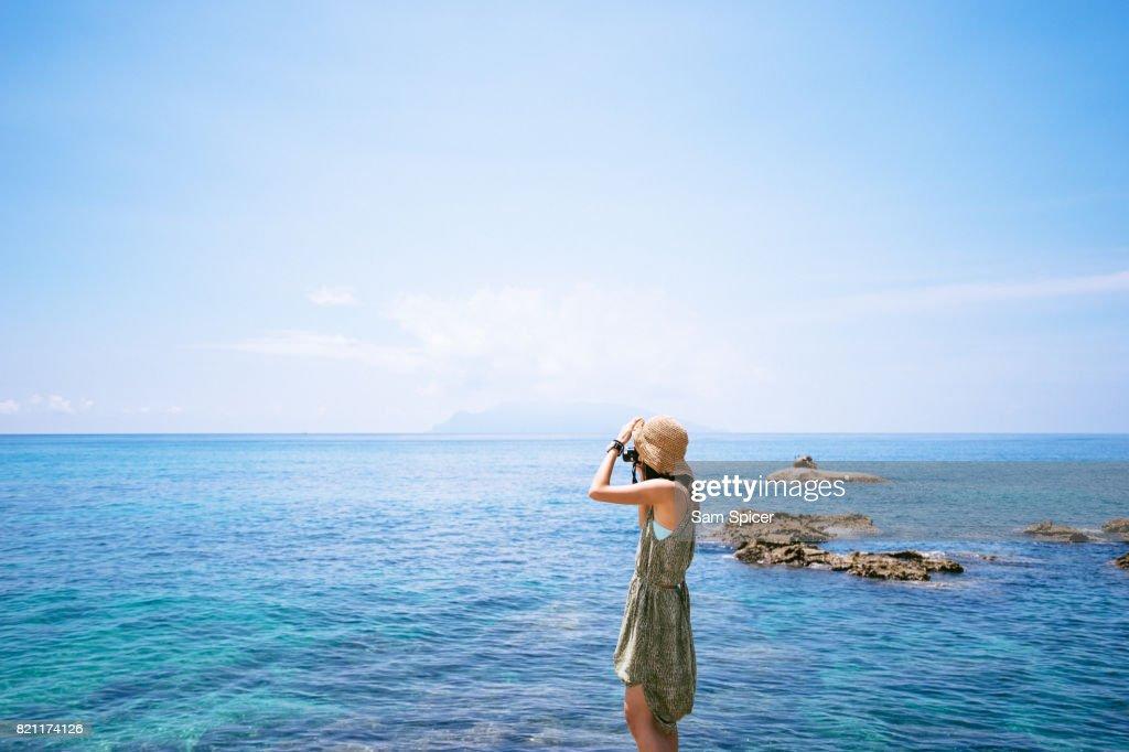Asian Tourist in Japan, Nagata Inakahama Beach, Yakushima, Japan : Stock Photo