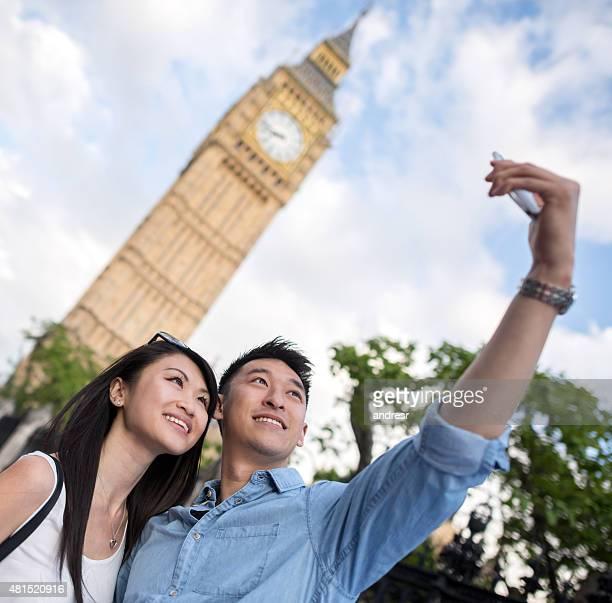 Asian tourist taking a selfie in London