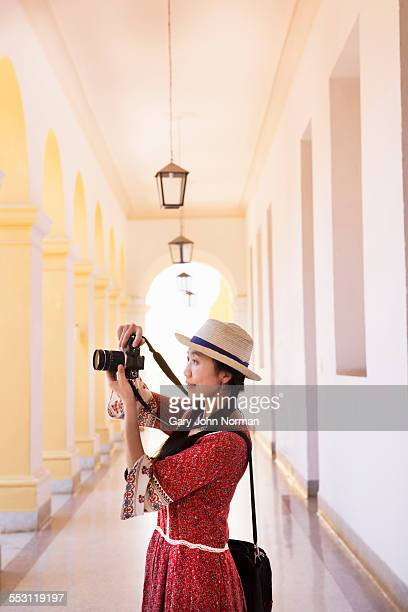 Asian tourist taking photos, Cuba