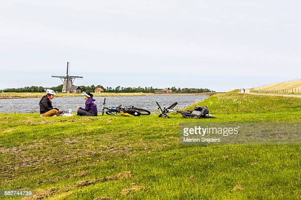 Asian tourists having lunch at windmill