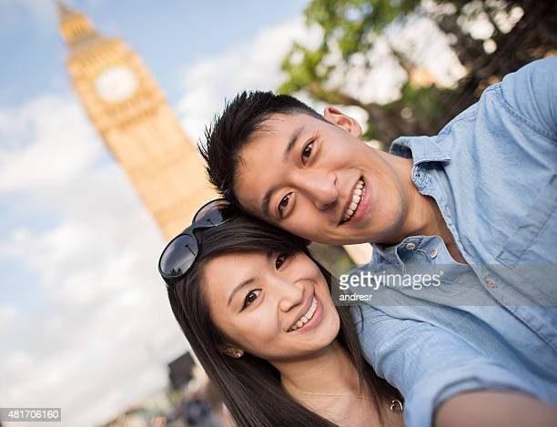 Asian tourists in London taking a selfie