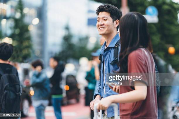asian tourists walking in shinjuku, tokyo - tourist stock pictures, royalty-free photos & images