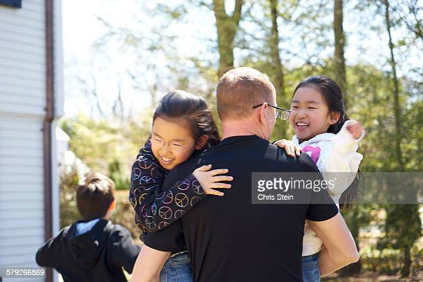 asian twin girls playing with dad - scarsdale stock photos and pictures