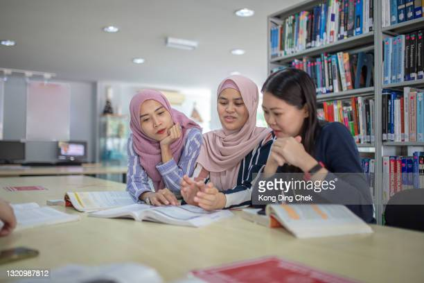 asian university student studying in library - small group of people stock pictures, royalty-free photos & images