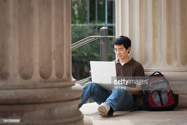 Asian University Student with Laptop Computer on College Campus