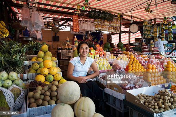 Asian vendor smiling at market