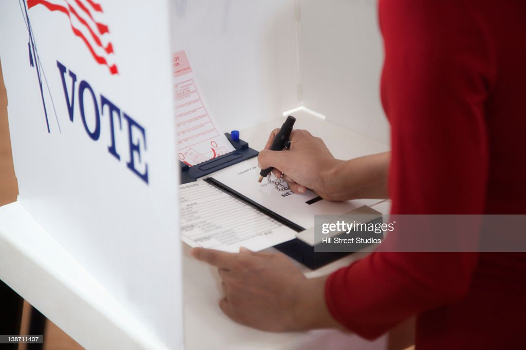 Asian voter voting in polling place : Stock Photo