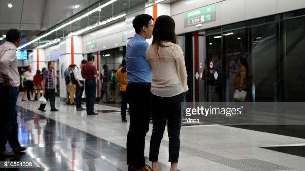 Asian waiting for transportation underground at Kuala Lumpur MTR