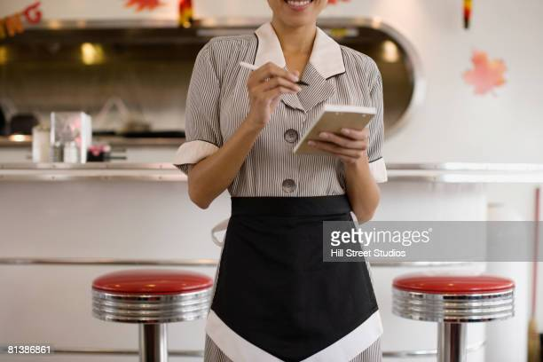 asian waitress taking order - diner stock pictures, royalty-free photos & images