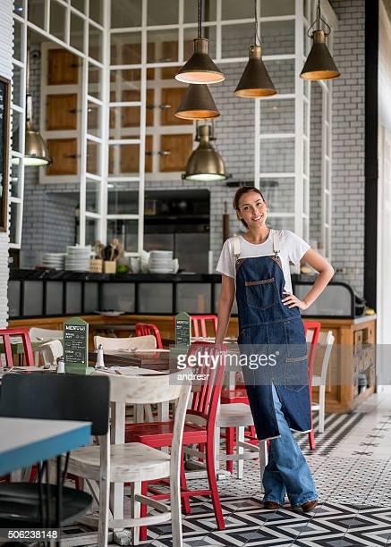 Asian waitress working at a restaurant