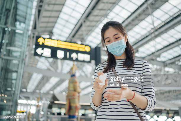 asian wearing face mask social distancing at suvarnabhumi international airport in bangkok thailand concept travel using mobile phone check-in  airport thailand covid-19 pandemic no people at counter - suvarnabhumi airport stock pictures, royalty-free photos & images