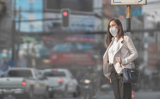Asian woman are going to work.she wears N95 mask.Prevent PM2.5 dust 1126464350
