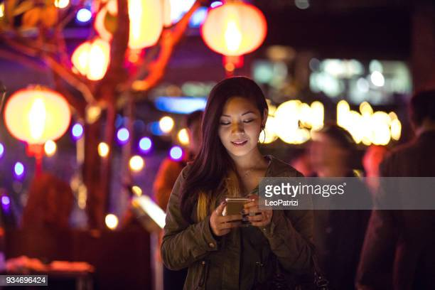 asian woman at night in downtown taipei - taiwan - taipei stock pictures, royalty-free photos & images