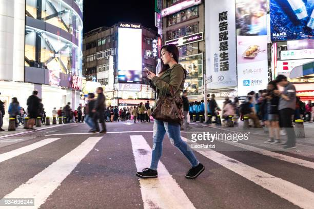 asian woman at night in ximen district downtown taipei - taiwan - taipei stock pictures, royalty-free photos & images